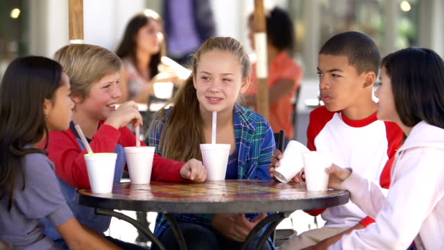 Group Of Children Hanging Out Together In Café video
