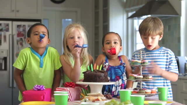 Group Of Children Having Fun At Birthday Party With blowers video