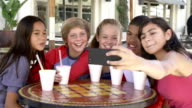 Group Of Children In Café Taking Selfie On Mobile Phone video