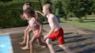 Group Of Children Jumping Into Outdoor Swimming Pool video