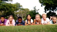 Group of children lying on grass video