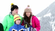 Group Of Children On Ski Holiday In Mountains video