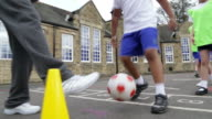 Group Of Children Playing Soccer In Physical Education Class video