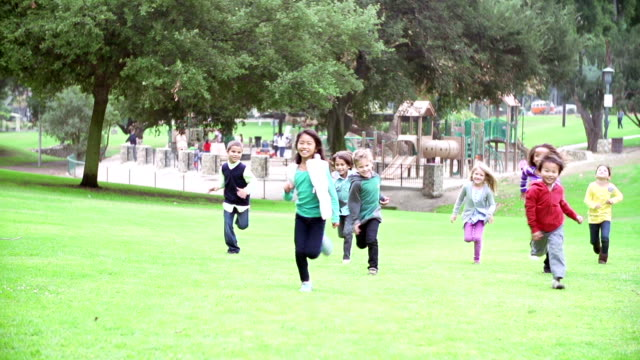 Group Of Children Running Towards Camera In Slow Motion video
