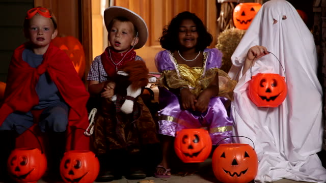 Group of children wearing Halloween costumes video