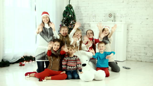 Group of childrens on the background of Christmas tree video