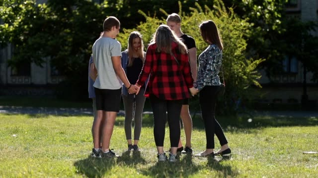 Group of christian students showing unity video
