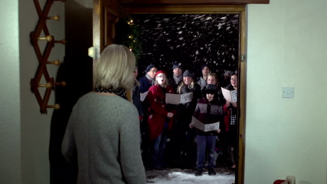 Group of Christmas Carol Singers, singing at the front door video