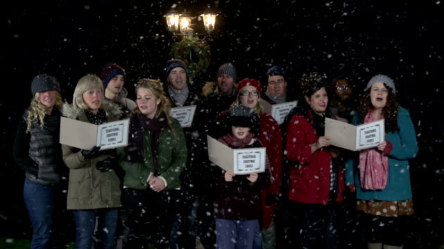 Group of Christmas Carol Singers, singing in the snow video