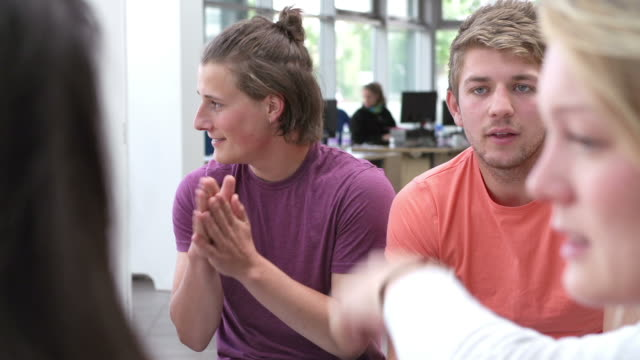 Group Of College Students Sitting And Working Together video