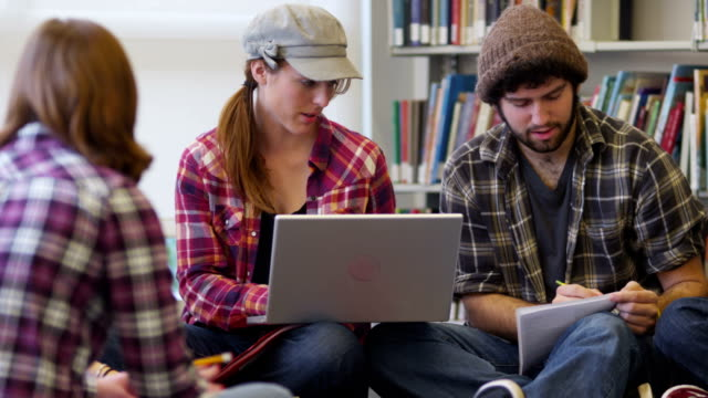 Group of college students studying in library video