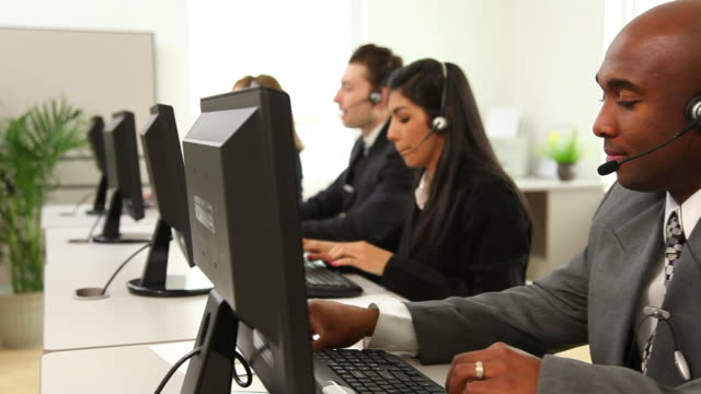 Group of customer service people at computers video
