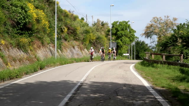 Group of cyclists on the road video