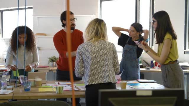 Group Of Designers Meeting Around Table In Modern Office video