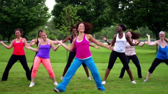 Group of diverse women doing Zumba outdoors video
