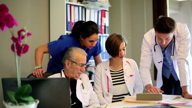 Group of doctors discussing medical case video