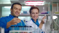 Group of doctors in clinical lab. Female and male doctor laughing in medical lab video