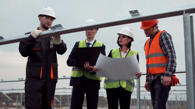 Group of engineers or technicians on a solar farm video