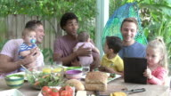 Group Of Fathers With Children Enjoying Outdoor Meal At Home video