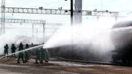Group Of Firefighters Watering Tank At Railway Station video