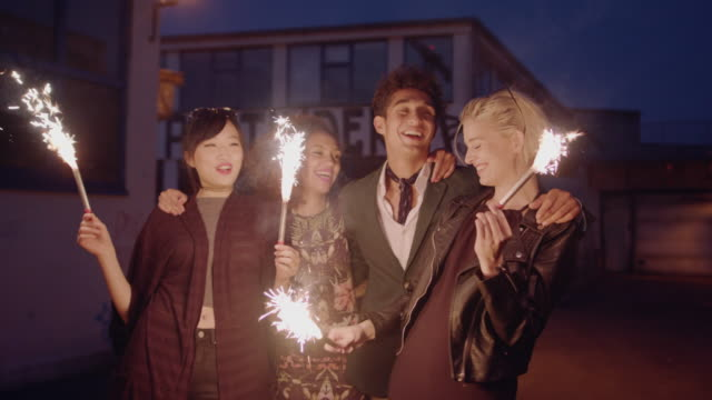 Group of friend enjoying with sparklers on city street video