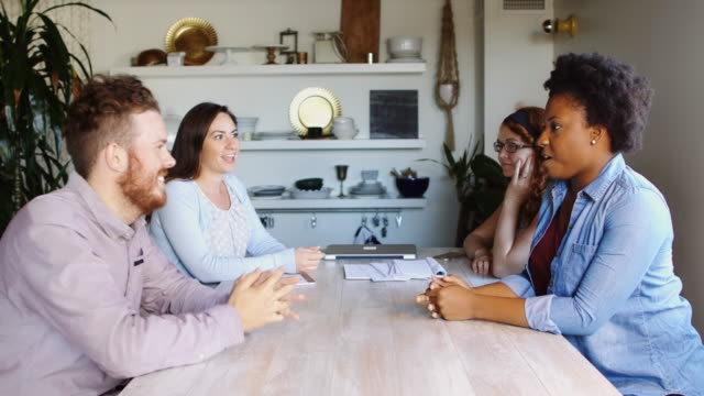 Group of Friends Chatting Around Dining Table video