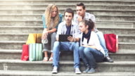 Group of friends consulting a touristic gude on digital tablet video