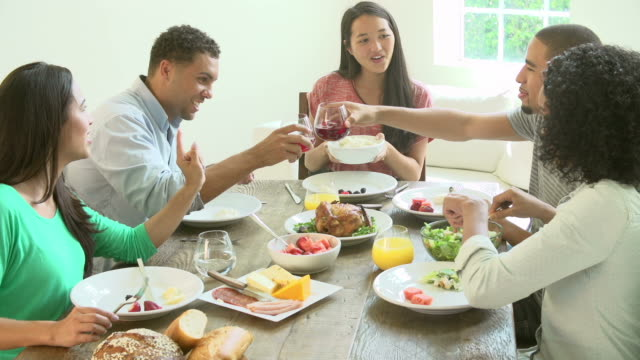 Group Of Friends Enjoying Meal At Home Together video
