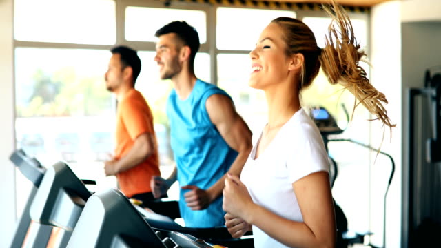 Group of friends exercising on treadmill machine video