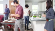 Group of friends gather for dinner in a kitchen, shot on R3D video