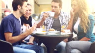 Group of Friends Having an Italian Breakfast: panning videoclip video