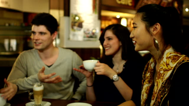 Group of friends having coffee together, Laughing and having fun video
