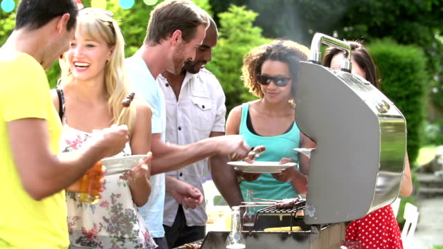 Group Of Friends Having Outdoor Barbeque At Home video