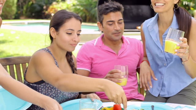 Group Of Friends Having Party In Backyard At Home video