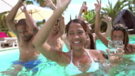 Group Of Friends Having Party In Pool Drinking Champagne video