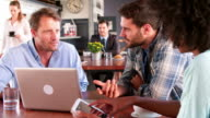Group Of Friends In Coffee Shop Using Digital Devices video