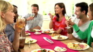 Group Of Friends Making Toast Around Table At Dinner Party video