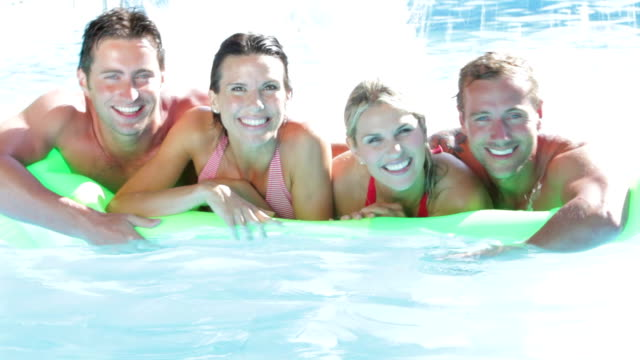 Group Of Friends On Holiday In Swimming Pool video