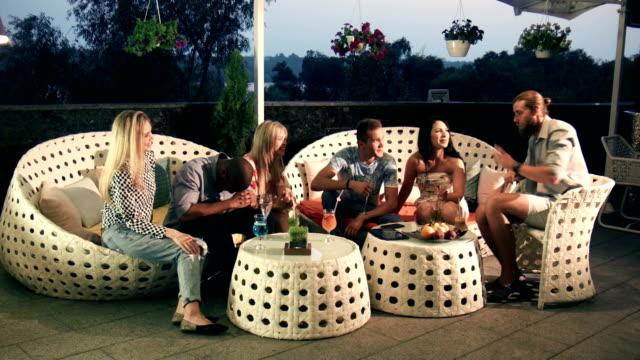 Group of friends relaxing at an upmarket bar video