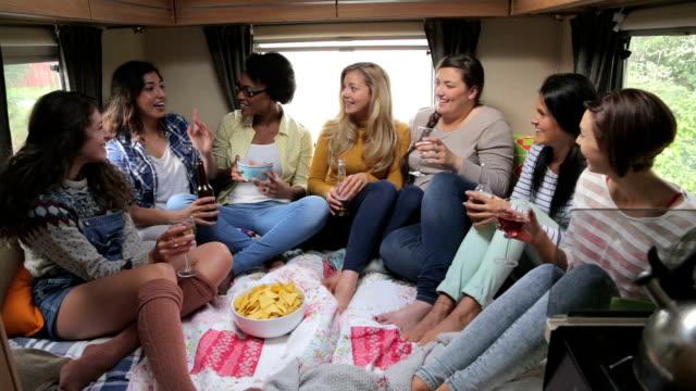 Group of Friends Relaxing in Caravan video