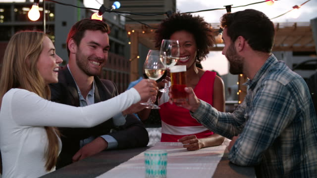 Group Of Friends Relaxing Together At Rooftop Bar video