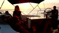 Group of friends sailing at sunset video