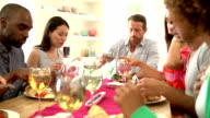 Group Of Friends Sitting Around Table Having Dinner Party video