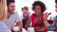 Group Of Friends Sitting In Coffee Shop Chatting video