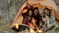 Group of friends sitting in the tent video