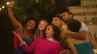 Group of friends taking a selfie together at a party video