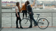 Group of friends together: he arrives with bicycle video