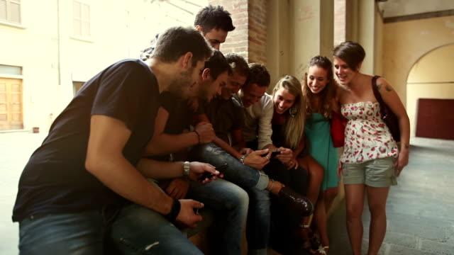 Group of friends watching sport on a digital tablet video