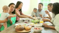 Group Of Friends With Babies Enjoying Meal At Home Together video