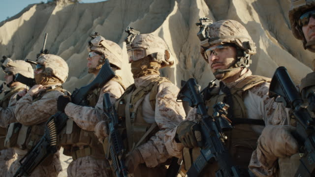 Group of Fully Equipped Soldiers Standing in a Line in the Desert. video